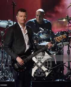 Bassist Ged Grimes (L) and drummer Mel Gaynor of Simple Minds perform during the 2015 Billboard Music Awards at MGM Grand Garden Arena on May 17, 2015 in Las Vegas, Nevada.