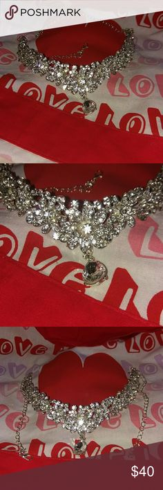 Sparkling Rhinestone neck piece. Sparkling Rhinestone neck piece great for a dazzling night... COULD HOLD THE WINNING $100.00. ONE NEVER KNOWS. Purchased because I was told it was a head piece.. Gorgeous.. Be Fabulous unknown Jewelry Necklaces