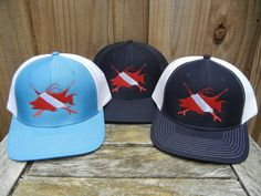 91328420d609f Hogfish Dive Spears Structured Trucker Hats by Reel Fishy Apparel