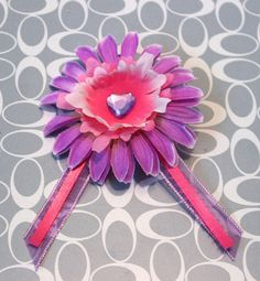 Little Miss Hair Clip by earthcharms on Etsy  Purple and pink ribbons, purple and pink flowers, and a pretty pale purple heart rhinestone. So much cute in one little package!