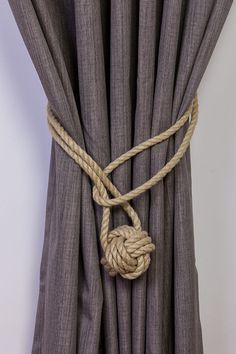 Beautiful Hemp Rope Curtain Tiebacks. Sold separately or as a pair. The thickness of the rope I use is 1cm. The tiebacks do not come with wall hooks.