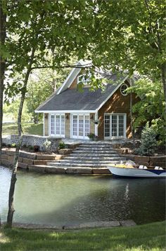 Lakeside lakefront cottage with wooden shaker siding and white trim. Lots of french doors that open out to the back deck porch and the lake. Steps down to the lake and boat dock. Cozy lake cottage home. Home design decor inspiration ideas. Lakeside Cottage, Lake Cottage, Cozy Cottage, Cottage Style, Waterfront Cottage, Riverside House, Nantucket Cottage, Lakeside Living, River Cottage