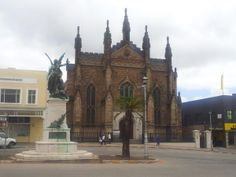 Grahamstown's gothic Commemoration Church, opened in Situated on High Street near the Cathedral, with Anglo-Boer War memorial statue in foreground. This is where you and Bessie got married ♡♡♡♡ Places Worth Visiting, Places To Visit, West Africa, South Africa, Iglesias, Afrikaans, Cape Town, Homeland, Barcelona Cathedral