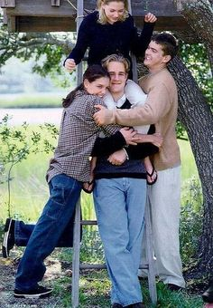 The gang excludes Jen from a group hug after an important meeting in their J. Crew treehouse.