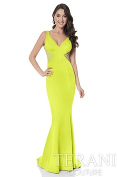 Fitted neoprene trumpet gown with semi-sweetheart neckline, finished with crystal embellished mesh cutouts at the side and back.