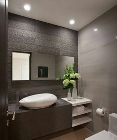 Contrast between mirror and textured wall tile