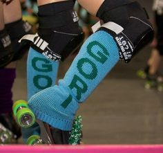Personalized leg warmers on Etsy.  Made by a nice lady in York, PA an hour from my house.