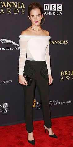 Emma picks an off-the-shoulder (and off-the-runway) Balenciaga top with sheer sleeves and sheer oblique panels, plus skinny black trousers, for the BAFTA L.A. Jaguar Britannia Awards in Beverly Hills. (oct 2014)