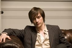 James McAvoy. In the times of his haircut of doom... Still pulls off the PERFECT smoulder...