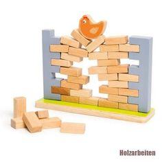 Pour jouer au jeu Une poule sur un mur, l'enfant commence par construire le ... Holzspiel... - #au #commence #Construire #Holzspiel #jeu #jouer #l39enfant #le #mur #par #poule #pour #sur #une