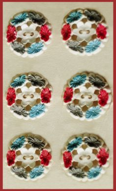 Vintage plastic floral buttons on card.