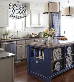 Rich Cobalt A blue-and-white color palette is traditonal, but the cobalt island is a bold take on the classic look. Outfitted with display space for a collection of dishware, the island is both pretty and practical.