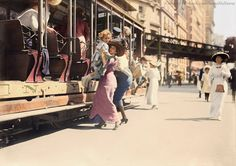 """Historic B&W photos restored in color: """"Slice of life! A mother helps her child off the trolley on a Broadway in New York City, July, 1913."""""""