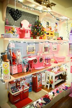 "Easy way to make an American Girl ""dollhouse"" with just shelving on the wall"