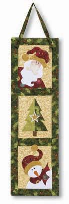 Jeri Kelly quilted wall hanging pattern featuring an applique Santa, applique Christmas tree, and applique snowman