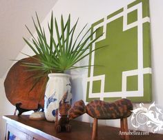 DIY artwork - painter's tape on canvas, paint over it, remove tape.  Love this pattern