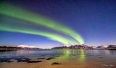 Aurora stretching over the horizon.Jan 17. 2014  at Stamnes beach, Sortland, Norway. Photographer Benny Hoynes from Norway - click through to see more! http://www.wanderingeducators.com/artisans/lives-artists/northern-lights-norway.html