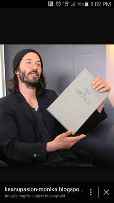 """Keanu Reeves and his book thar he wrotw """"Ode of Happiness """""""