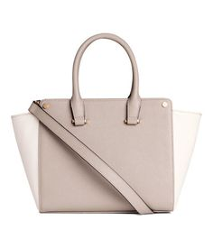 Light taupe/white. Small handbag in grained faux leather with two handles, a zip at top, and a narrow, detachable shoulder strap. One inner compartment with