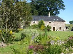 Renovated 18th Century Stables Scottish Highlands Tastefully converted into two luxury apartments surrounded by beautiful parkland gardens. Near the Moray Coast with fine beaches and sand dunes.