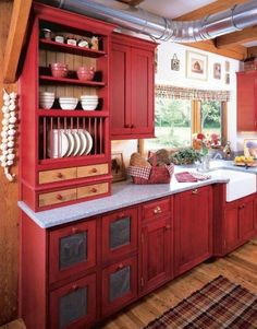 Red Wooden Kitchen Cabinet Red Themes Kitchen Marble Countertop Wooden Tiles Flooring Wooden Beams Single Pull Down Faucet Flower Vases White Wall Kitchen Rack Cutting Vegetables Mate Red Kitchen Modern Trend kitchen yellow kitchen. kitchen color trends. kitchen color schemes.