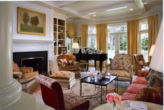 Living Room - Benson Interiors  Boston, Ma  www.bensoninteriors.com #livingroom #gold #yellow #red #bookcase #interiordesign #windowtreatment #ottoman #chair #tuftedchair #fireplace #carpet #traditional