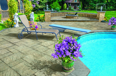 Create an outdoor oasis. This backyard features Cambridge's Sherwood Collection Ledgestone XL in Sandstone Blend.