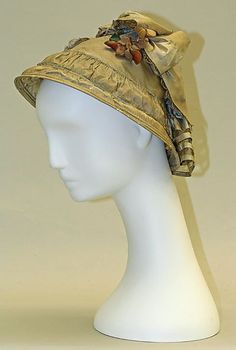 """1854-55 Silk. This sweet bonnet isn't sitting on the mannequin's head properly. It should be sitting at the back of the heat, exposing the face. It would have been held in place by """"kissing strings"""" and a sturdy """"Yankee Sticker""""."""