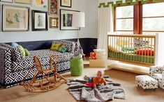 Jennifer Delonge   Adore Mag    fun, colorful eclectic nursery design with David Hicks La Fiorentina fabric upholstered settee, natural woven rug, bright green garden stool, chalkboard wall, blue walls, white cornice box with green trim, West Elm Adjustable metal Floor Lamp, white modern crib and eclectic art gallery.