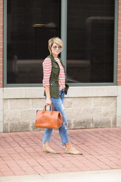 Seersucker and Saddles. Red striped longsleeve+distressed cropped jeans+leopard print flats+brown handbag+khaki utility vest+sunglasses. Fall outfit 2016