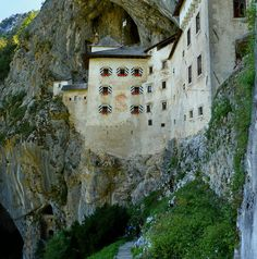 Predjama Castle is a Renaissance castle built within a cave mouth in southwestern Slovenia, located just 10 kilometres from Postojna. The castle was built under a natural rocky arch high in the stone wall to make access to it difficult.