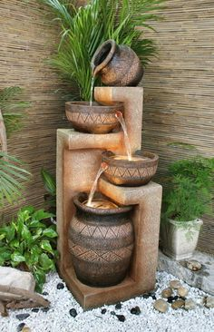 Water feature - I would love to have this ... maybe without water and with trailing plants. Gotta think about this.