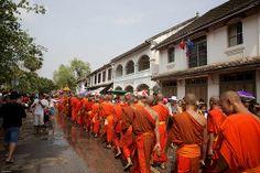 laos-luang-prabang-laos-new-year-phi-mai-lao-young-monks-in-orange-robes-walk-down-main-street-for-parade-tiger trail-cyril-eberle CEB-5496.jpg