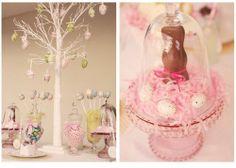placing baby girl shoes inside of cake platter.