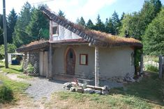 Cob home with green roof. Built by members of cobworks.com