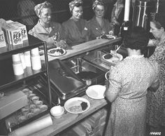 Women Ordnance Workers.  Warm, appetizing, and substantial lunches served the explosive-area workers in bomb shelters. Only 38 cents.  Left to right: Mrs. Delia Evans, Mrs. Alva Lou Snow, Mrs. Margaret Kitchins.  (1943)