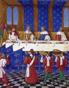 Banquet donné lors de la venue de l'empereur. À gauche Charles IV, au centre Charles V, et à droite Wenceslas le roi de Rome. Grandes Chroniques de France, Fr.6465, folio 444v.