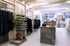 Using raw and industrial materials like spruce pine, concrete and untreated steel - with clean white finishes elsewhere - sfd designed a contrast between the interior's starkness and the vivid shopfront.