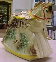 1950's McCoy Hobby Horse Cookie Jar.   The English used the term 'biscuit' for a small tea cake or scone, which in the U.S. translates as 'cookie'.