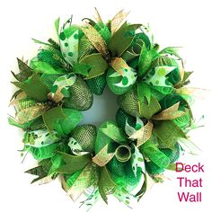 This festive St. Patrick's Day mesh wreath is made with three different shades of green mesh, featuring Moss premium, Emerald Premium, and Green deluxe with foil. All ribbons used on the wreath are wi