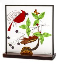 Charley Harper was a Cincinnati-based artist, best known for his stylized wildlife prints, posters and book illustrations. This exquisite adaptation of Charley's A Good World, available at our all-new online store, is framed with a copper patina frame for an antique feel and is perfect for desktop display or hanging. Available for $109 at http://the-dayton-art-institute-museum-store.mybigcommerce.com/a-good-world-art-glass/.