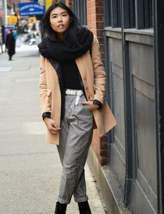 Sharena Chindavong wears a camel coat and grey pegged trousers. Shop the Look at Fashiolista.com