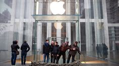 People pose outside the sandbagged entrance of the closed Apple Store on Fifth Avenue as Hurricane Sandy moves closer to the area on October 2012 in New York City. Hurricane Pictures, Hurricane Irene, People Poses, American Red Cross, East Coast, New York City, Entrance, Store, October 29