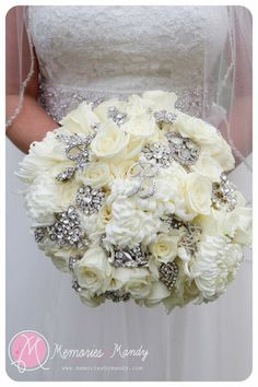 not with roses, but I love both brooch bouquets and florals... nice to see them entwined