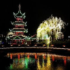 With fairy-lights cascading from trees and colored lights glowing from the 115 year-old Japanese pagoda, Tivoli lake looks especially pretty at night :) #KeepCalmAndJasTravel Copenhagen, Denmark