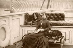 Victorian Lady with her two dogs on a ship or boat of some kind… - #dog #dogs