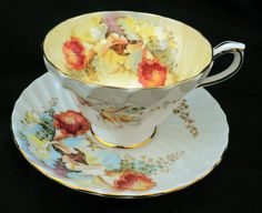 Aynsley peach orchid pastel yellow swirl art deco tea cup and saucer
