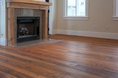 """This custom mantle was made from RECLAIMED heart pine. - Prefinished """"Harvest Blend"""" RECLAIMED wide plank flooring."""
