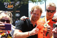Prince Harry Photos Photos - Prince Harry takes a photo with fans during the Invictus Games Orlando 2016 Cycling Finals at the ESPN Wide World of Sports Complex on May 9, 2016 in Lake Buena Vista, Florida. - Invictus Games Orlando 2016 - Day 1 - Cycling Finals