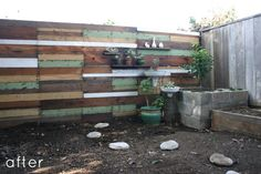 check out this cool salvaged wood fence - really like the inset shelves, too.